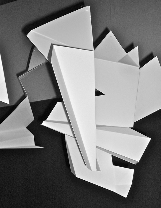 """Hochhauser   """"S188 Shapes in Space""""   Folded, cut, and shaped paper with music   19' x 29' x 49'"""